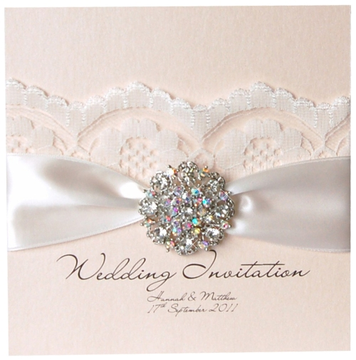 A vintage style lace invitation featuring a vintage crystal cluster