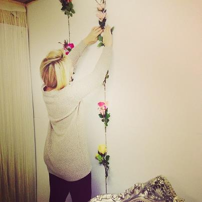Clare decorating the giant flower wall