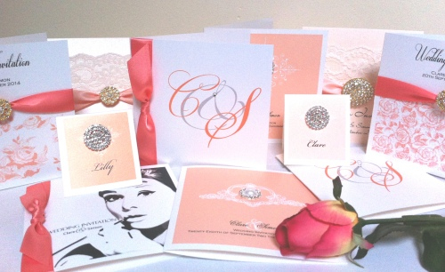 Corals, peaches and blush shades of invitations