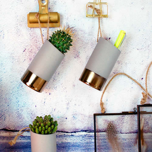 Cool little concrete grey mini vases that can display pens, mini cactus plants, succulents with gold brass bottom trim & twine rope to hang