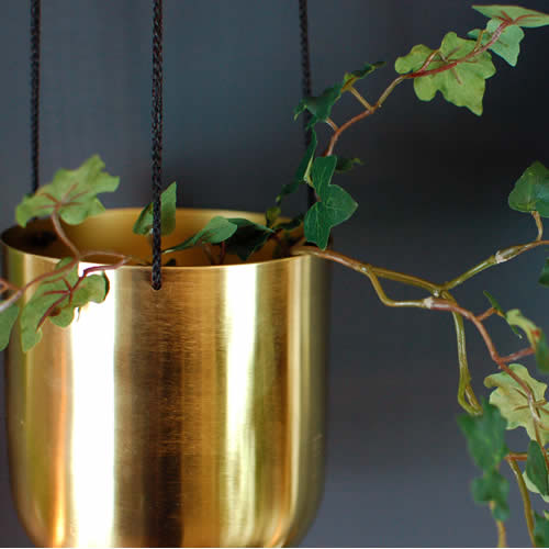 Instant spring update: add a plant in a pretty brass planter of course!